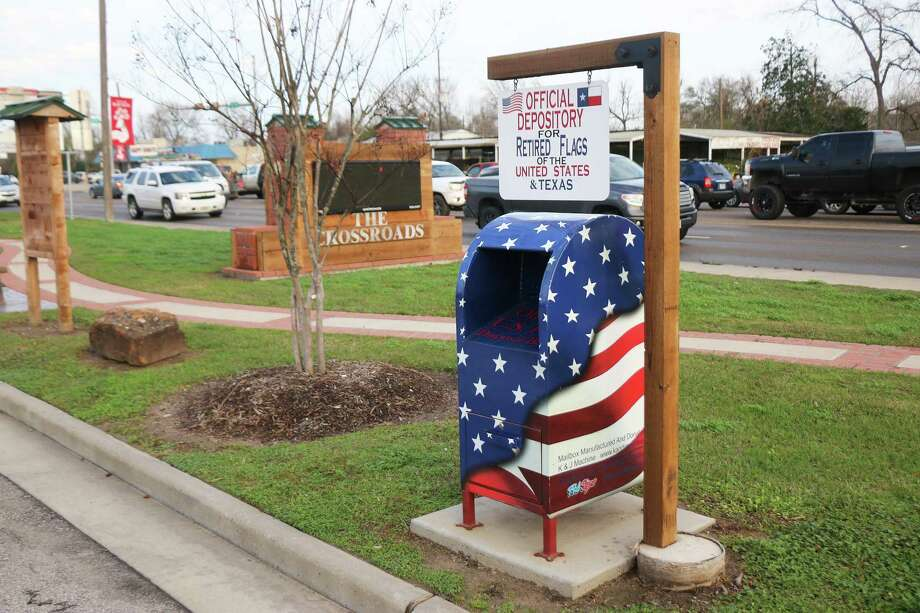 For nearly two years, the red, white, and blue U.S. flag repository located in The Crossroads, located at 111 N. Church St. parking lot has been the sacred collector of worn flags ready for disposal. Photo: David Taylor / Staff Photo