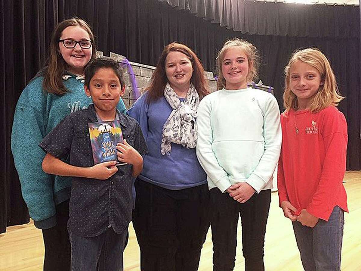 Fifth-grade students took time to pose with Kelly following her presentation.