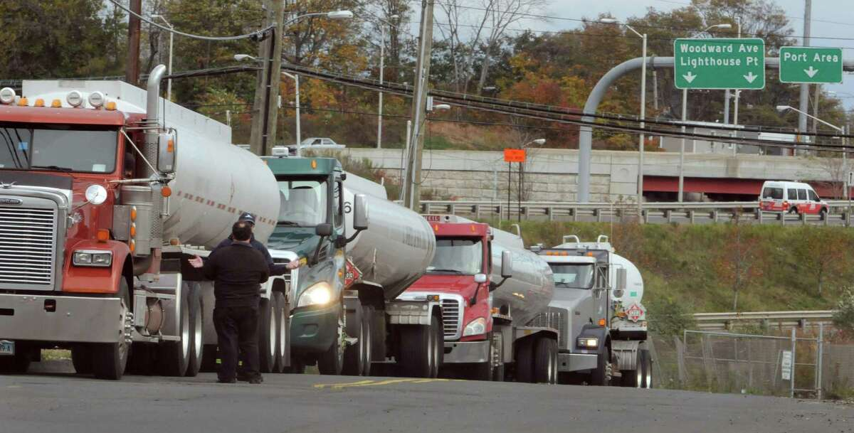 Delivery tanker trucks line up and wait to load up at the New Haven Petroleum Terminal.