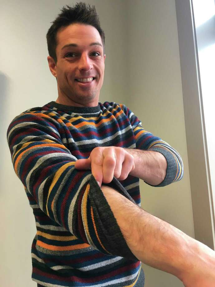 Sunny 97.3 marketing and disc jockey Kyle Wells says goodbye to his arm hair before waxing it off Friday. According to Wells, the waxing is part of a fundraiser in hopes of raising money for Our Brother's Keeper. (Pioneer photo/Tim Rath)
