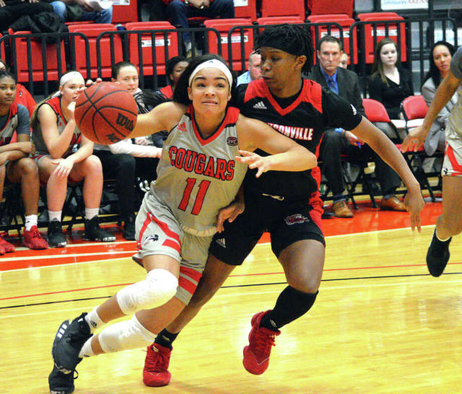 SIUE's Mikia Keith, left, drives to the basket during Saturday's Ohio Valley Conference game against Jacksonville State at First Community at the Vadalabene Center. Photo: Scott Marion/The Intelligencer