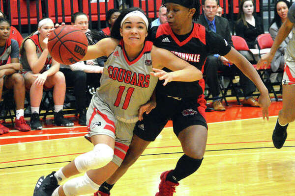SIUE's Mikia Keith, left, drives to the basket during Saturday's Ohio Valley Conference game against Jacksonville State at First Community at the Vadalabene Center.