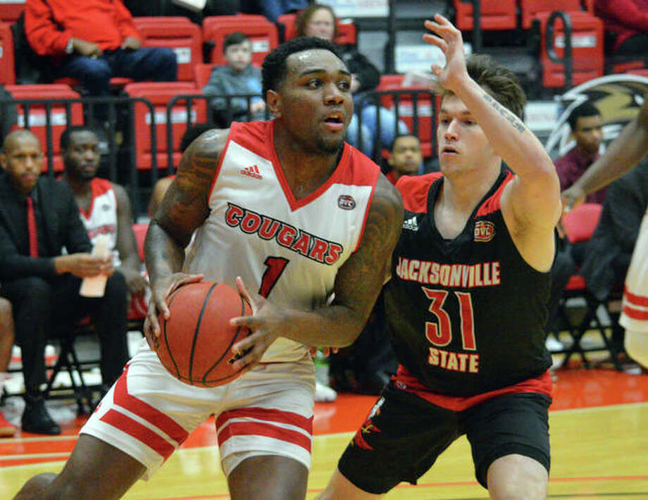 SIUE sophomore Kenyon Duling, left, drives to the basket during Saturday's Ohio Valley Conference game against Jacksonville State at First Community Arena at the Vadalabene Center. Photo: Scott Marion/The Intelligencer