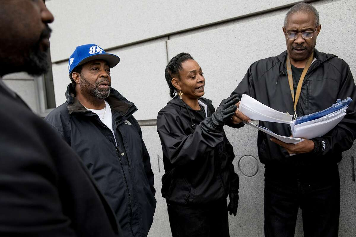 (From left) Attorney Stanley Goff, former Treasure Island residents Orlando Arnold, Felita Sample and Andre Patterson holds a press conference announcing a lawsuit while outside of the Superior Court of California building in San Francisco, Calif. Tuesday, Jan. 21, 2020. Patterson, Sample and Arnold along with other current and former residents of Treasure Island are suing the City of San Francisco and state of California, alleging that they lied about contamination on the island.