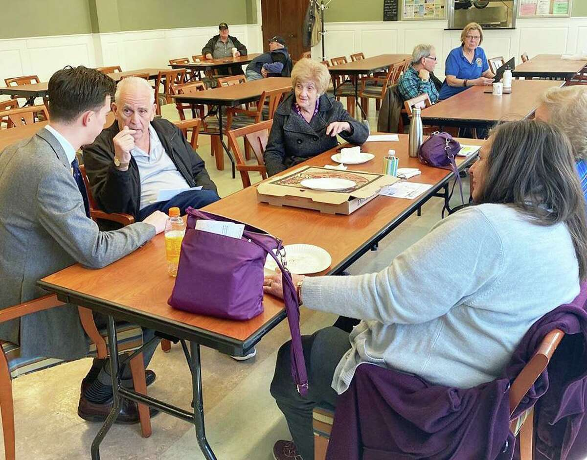In this file photo, Middletown Mayor Ben Florsheim, left, meets with members of the Middletown Senior Center listening to older residents describe issues they're most concerned about. The center is closed through at least April 13 due to the coronavirus pandemic.