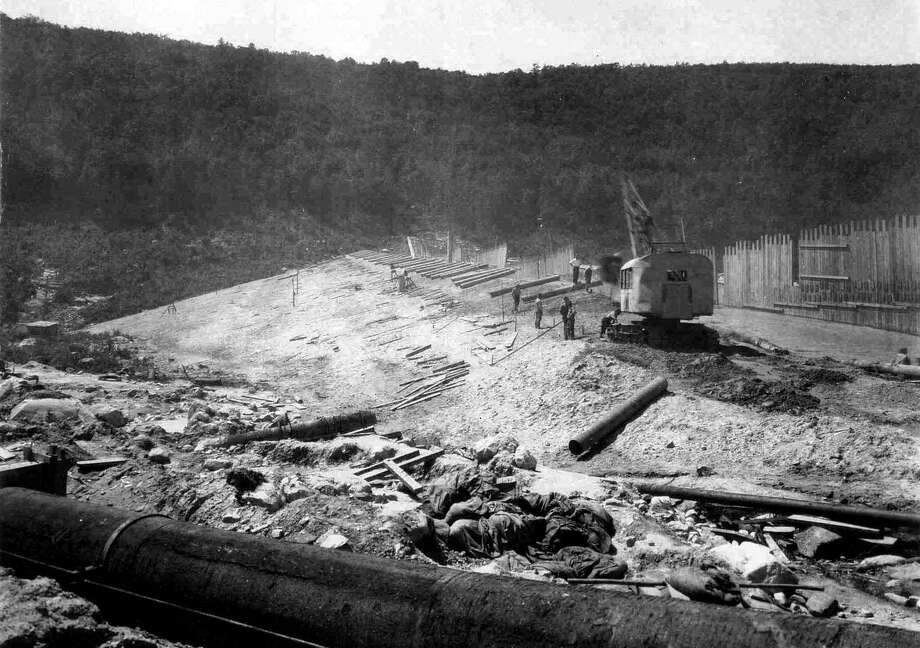 "A handout historical photo from CL&P dated Aug. 15, 1927 of the construction of the dam at the north end of what was to be Candlewood Lake. In the foreground is the pipe to be used to pump water from the Housatonic River into the lake from the Rocky River power-generating station along Route 7 in New Milford. If you have a ""Flashback"" photograph you'd like to share, contact Deborah Rose at drose@newstimes.com or 860-355-7324. Photo: Courtesy Of CL&P / The News-Times Contributed"