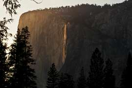 The natural fire fall on the rock formation know as El Capitan about to begin. The fire fall happens once a year during late February. A combination water falling from Horsetail fall, clear atmospheric conditions, and late afternoon sun are all needed to make the fire fall appear. Hundreds of nature watchers line up near El Capitan to see this phenomenon. (Photo by Ted Soqui/Corbis via Getty Images)