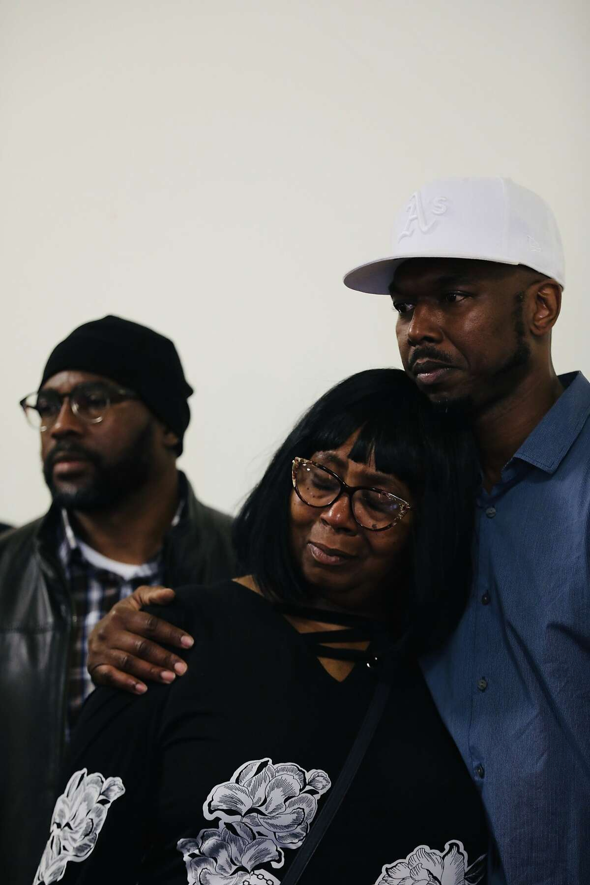 John Jones III, campaign director for Alameda County Fair Chance to Housing Coalition, hugs Ms. Towanda Sherry, after she shared her story of not being to provided housing to her formally incarcerated son, the late Simbarashe Sherry, during a press conference hosted by the Alameda County Fair Chance Housing Coalition, led by Just Cities, at Oakland City Hall in Oakland, Calif., on Tuesday, January 21, 2020. California's system of mass incarceration has disproportionately targeted people of color and failed to provide them with the resources and support to succeed after their release. The Fair Chance Housing Coalition has been fighting to remove the structural barriers that prevent formerly incarcerated people from accessing housing; Oakland's ordinance is an essential first step toward restorative justice.