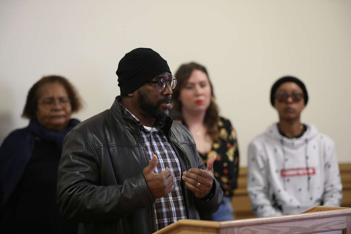 """Lee """"Taqwaa"""" Bonner, Housing advocate, Legal Services for Prisoners with Children, shares his experiences with attempting to find housing during a press conference hosted by the Alameda County Fair Chance Housing Coalition, led by Just Cities, at Oakland City Hall in Oakland, Calif., on Tuesday, January 21, 2020. California's system of mass incarceration has disproportionately targeted people of color and failed to provide them with the resources and support to succeed after their release. The Fair Chance Housing Coalition has been fighting to remove the structural barriers that prevent formerly incarcerated people from accessing housing; Oakland's ordinance is an essential first step toward restorative justice."""
