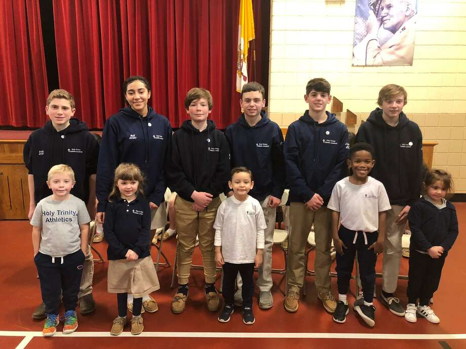 Holy Trinity Catholic Academy held its eighth grade pin ceremony Thursday, Jan. 16. Pictured are (back, left to right) Alex Balko, Tatiana Bell, Jacob Bisset, Matthew Conelius, Nicolas Coppola and Brady Grinvalsky with their kindergarten buddies (front, left to right) Jordan, Molly, Mason, Matai and Abby. Photo: Brian Gioiele / Hearst Connecticut Media / Connecticut Post