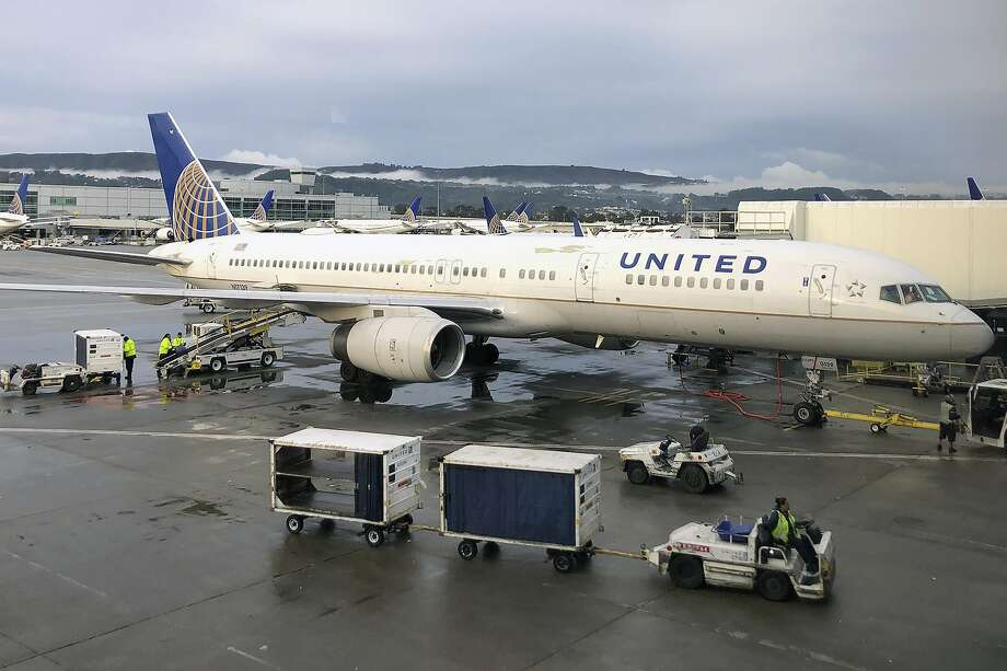 United Airlines is following the lead of Jet Blue, which raised its checked baggage fee last month. Photo: Jeff Chiu, Associated Press