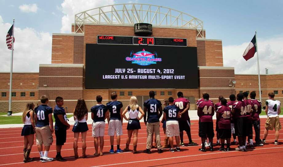 Humble area students and athletes watch a presentation on the new 960 square foot Horizon Pro Video Display Board at Turner Stadium on Tuesday, June 12, 2012 in Humble, Texas. The video board has been installed in preparation for over 15,000 youth athletes that will compete at the 2012 AAU Junior Olympic games, and is the biggest video board in a high school stadium in the United States. ( J. Patric Schneider / For the Chronicle )>>>See more for Texas' most expensive high school stadiums... Photo: J. Patric Schneider, Freelance / For The Chronicle / Houston Chronicle