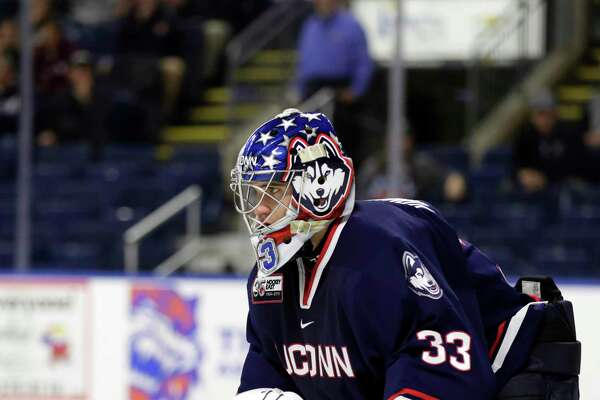 Connecticut Huskies goaltender Tomas Vomacka (33) in action against Sacred Heart Pioneers during an NCAA hockey game on Saturday, Oct. 5, 2019 in Bridgeport, Conn. (AP Photo/Adam Hunger)