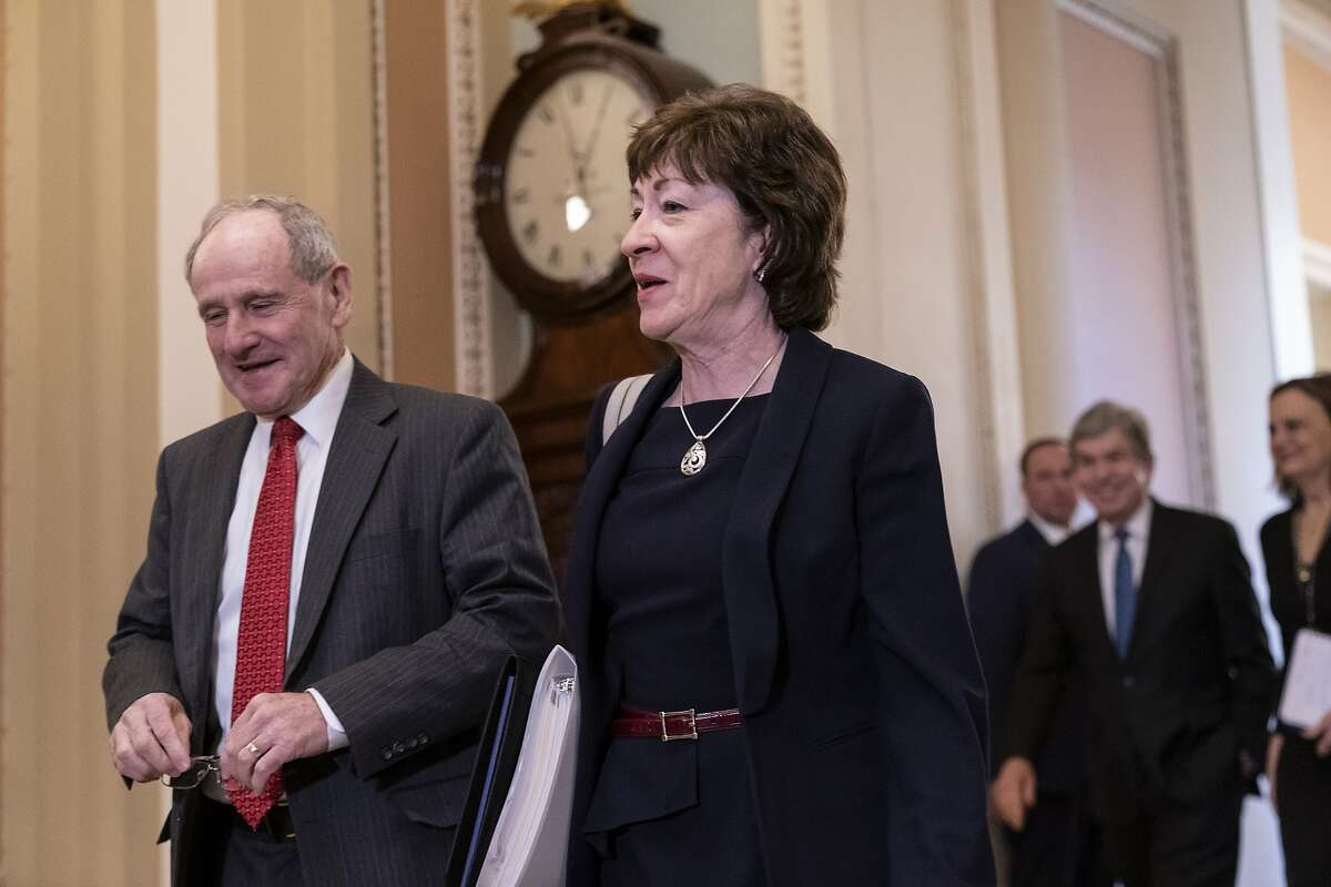 Sen. Jim Risch, R-Idaho, chairman of the Senate Foreign Relations Committee, left, walks with Sen. Susan Collins, R-Maine, as they arrive at the Senate for the start of the impeachment trial of President Donald Trump on charges of abuse of power and obstruction of Congress, at the Capitol in Washington, Tuesday, Jan. 21, 2020.