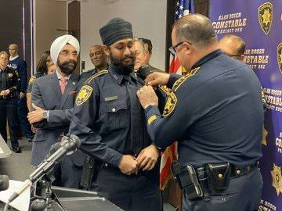 Harris County Constable Deputy Amrit Singh (left) is pinned by Precinct 1 Constable Alan Rosen (right) after being sworn in on Tuesday, Jan. 21. Singh is Harris County's first Sikh deputy constable. Photo: Courtesy By Harris County Constable Precinct 1