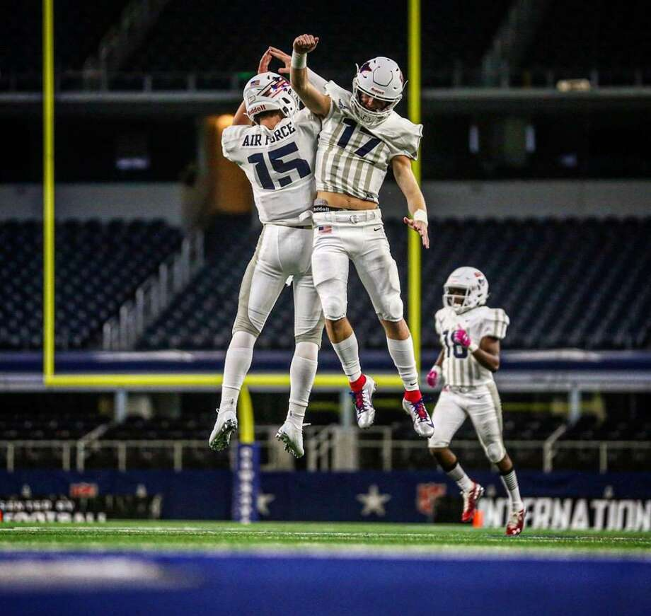 Danny Lauter, left (No. 15) celebrates during the 2020 High School International Bowl, which was held at AT&T Stadium in Arlington, Texas on January 15, 2020. Lauter, a Brunswick School junior, was one of the U.S. team's quarterbacks. Photo: Photo Courtesy Of USA Football /Photos Courtesy Of USA Football