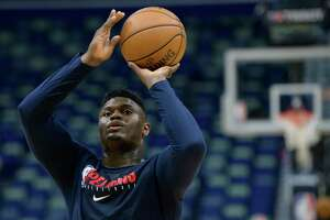 New Orleans Pelicans forward Zion Williamson (1) practices before an NBA basketball game between the New Orleans Pelicans and the Los Angeles Clippers in New Orleans, Saturday, Jan. 18, 2020. Williamson is expected to return to play Wednesday against the San Antonio Spurs. (AP Photo/Matthew Hinton)