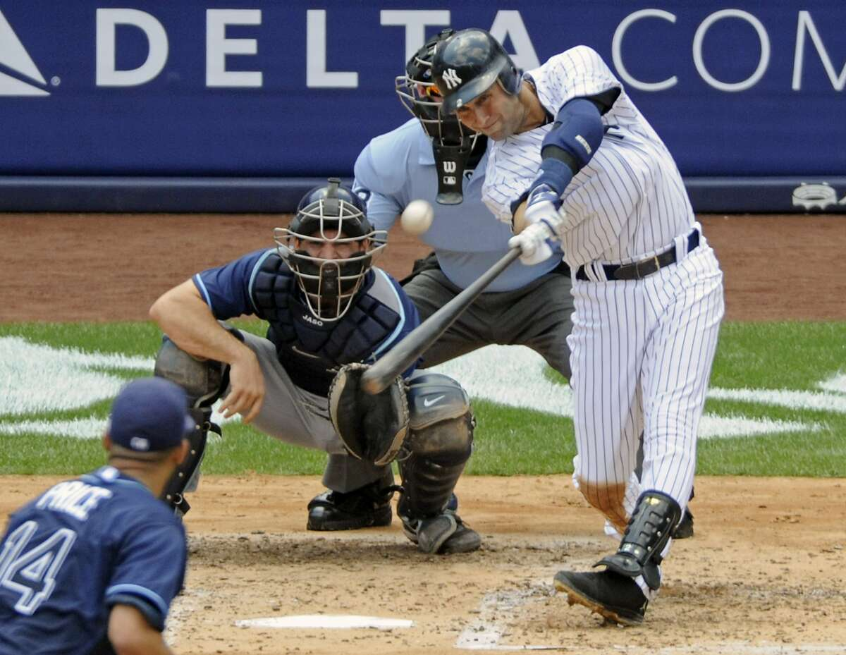 In this July 9, 2011, file photo, New York Yankees' Derek Jeter hits a home run for his 3,000th career hit during the third inning of a baseball game against the Tampa Bay Rays at Yankee Stadium in New York. Back in 1994, Jeter hit .377 with 12 stolen bases in 34 games with the Albany-Colonie Yankees. Click on the link to see some of his career highlights. https://www.youtube.com/watch?v=2xHpevdVa1U (AP Photo/Bill Kostroun, File)