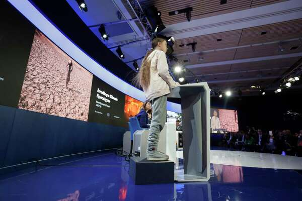 Swedish environmental activist Greta Thunberg stands on an elevation as she addresses guests at the World Economic Forum in Davos, Switzerland, Tuesday, Jan. 21, 2020. The 50th annual meeting of the forum will take place in Davos from Jan. 21 until Jan. 24, 2020. (AP Photo/Michael Probst)