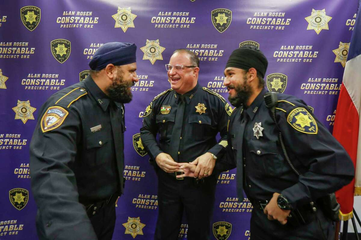 "Harris County Sheriff Deputy Navdeep Nijjar, Constable Alan Rosen and Deputy Amrit Singh share a light moment after Singh was sworn-in Tuesday, Jan. 21, 2020, in Houston. Singh is the first Sikh Deputy Constable in Harris County history. His swearing-in coincides with the adoption by nearly all Harris County Constables of a religious ""Articles of Faith"" policy which allows all those who serve to wear articles of faith while discharging their duties in uniform."