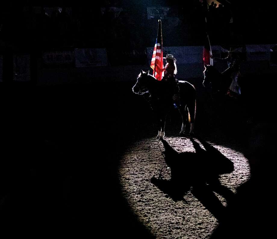 Jordan Maldonado presents the American flag during the national anthem last year at the Sandhills Rodeo in Ector County. Photo: File Photo