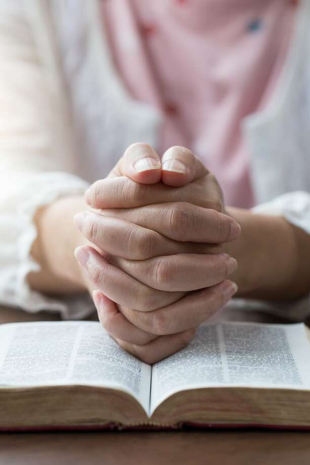 The mayor of a small Dallas suburb told a fellow City Council member in an email that women shouldn't be allowed to lead prayer at public meetings because it goes against the Bible. Photo: Manusapon Kasosod, Getty Images