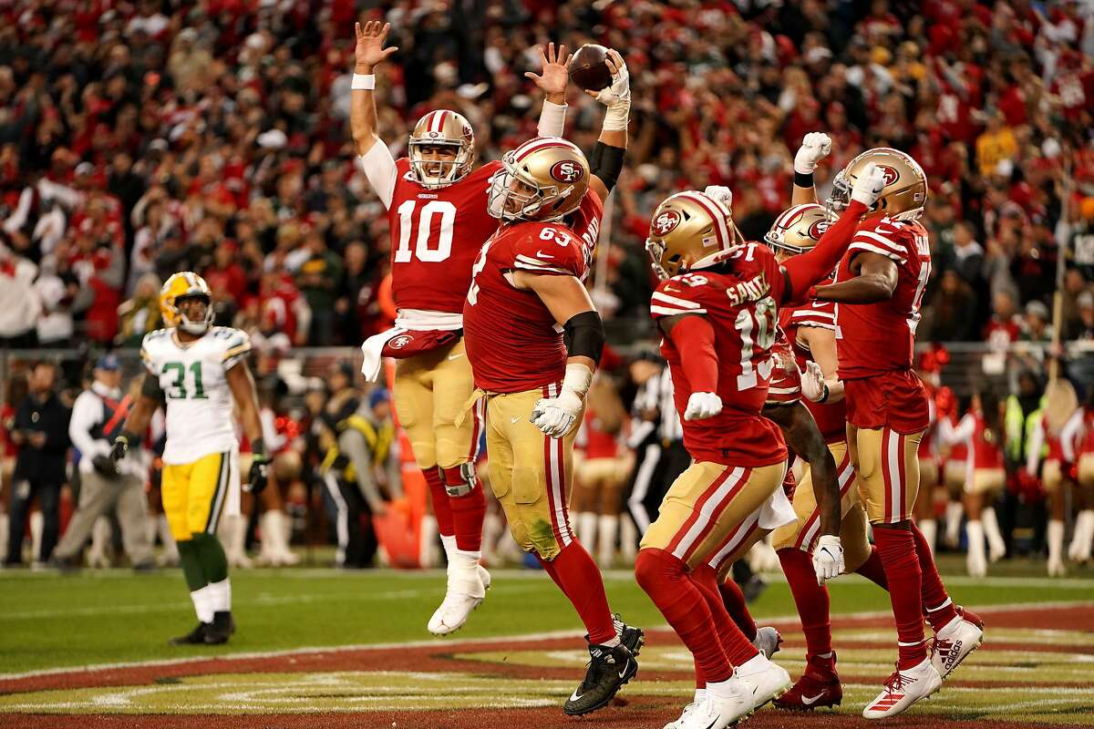 SANTA CLARA, CALIFORNIA - JANUARY 19: Jimmy Garoppolo #10 and Ben Garland #63 of the San Francisco 49ers celebrate a touchdown in the second quarter against the Green Bay Packers during the NFC Championship game at Levi's Stadium on January 19, 2020 in Santa Clara, California. (Photo by Thearon W. Henderson/Getty Images)