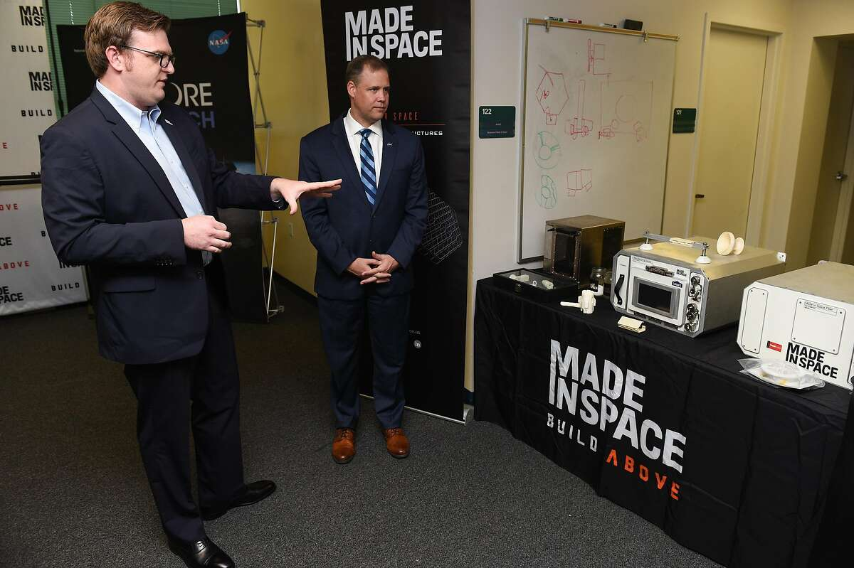 Andrew Rush, President and CEO of Made In Space, left, shows off three generations of 3D Printers which were used in space during a tour for NASA Administrator Jim Bridenstine at the Made In Space headquarters on the NASA Ames Research Center in Mountain View on Monday August 26, 2019.