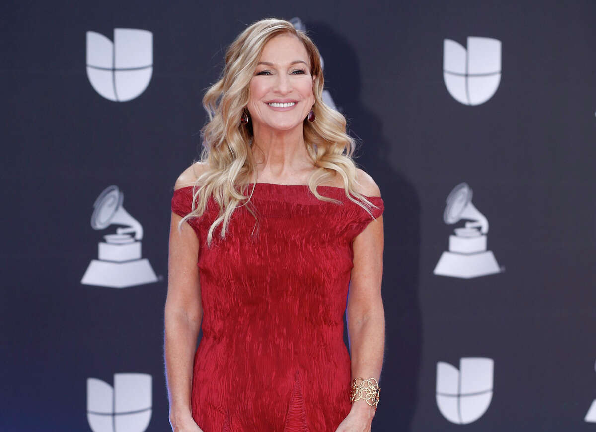 FILE - This Nov. 14, 2019 file photo shows Grammys CEO Deborah Dugan at the 20th Latin Grammy Awards in Las Vegas. Dugan has fired back at the Recording Academy with a complaint claiming she was retaliated against after reporting she was subjected to sexual harassment and gender discrimination during her six-month tenure. Lawyers for Dugan, who the academy placed on administrative leave last week, filed a discrimination case with the Equal Employment Opportunity Commission on Tuesday. In the complaint, she claims she was subjected to sexual harassment from the academya€™s general counsel. (Photo by Eric Jamison/Invision/AP, File)