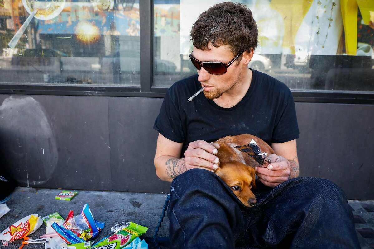 A man who wished to remain anonymous readies to smoke Fentanyl on Turk Street in San Francisco, California, on Monday, Oct. 14, 2019.