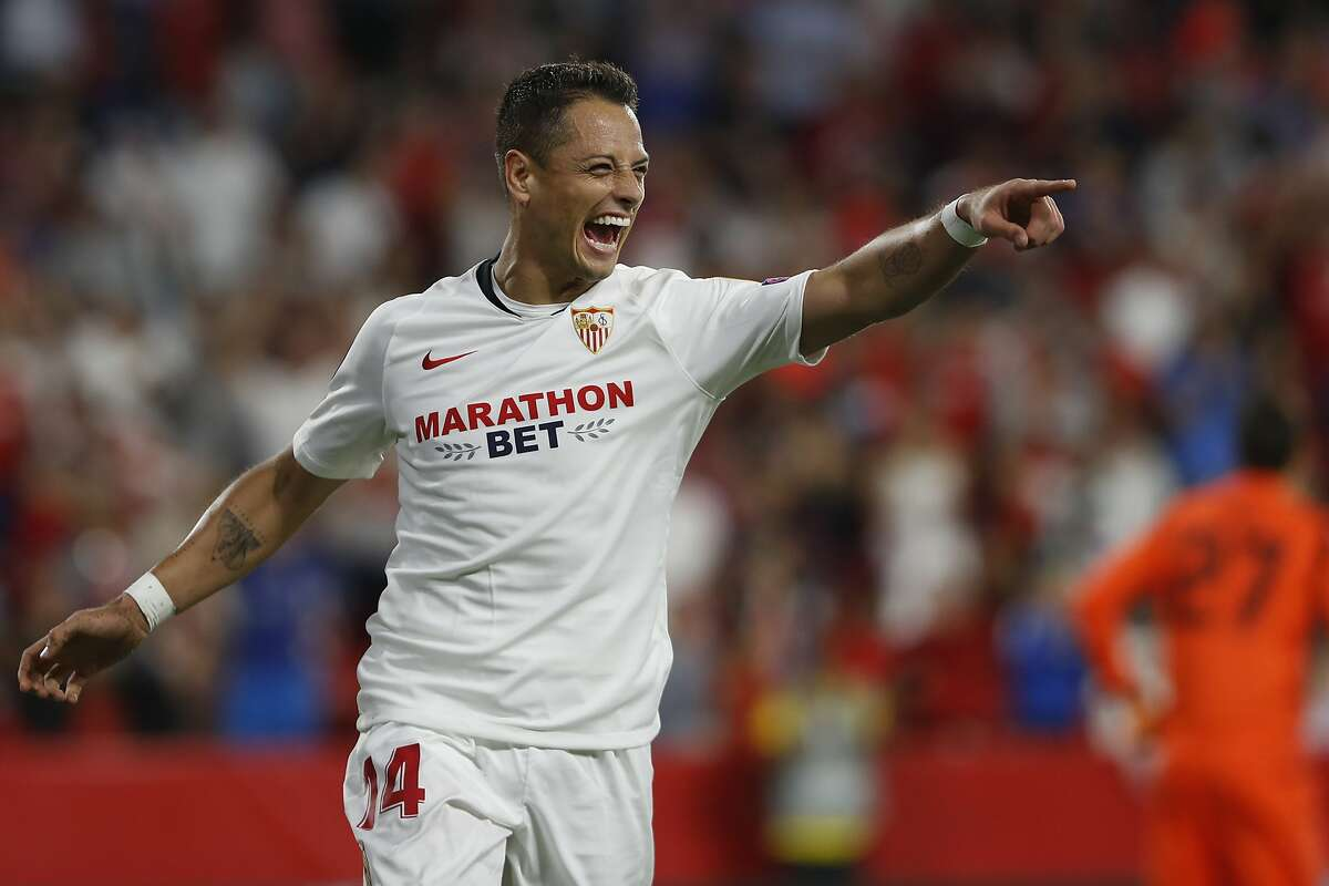 FILE - In this Oct. 3, 2019, file photo, Sevilla's Javier Hernandez celebrates after scoring his side's opening goal during a Europa League group A soccer match against APOEL Nicosia at the Estadio Ramon Sanchez-Pizjuan stadium in Seville, Spain. The Los Angeles Galaxy have signed Javier