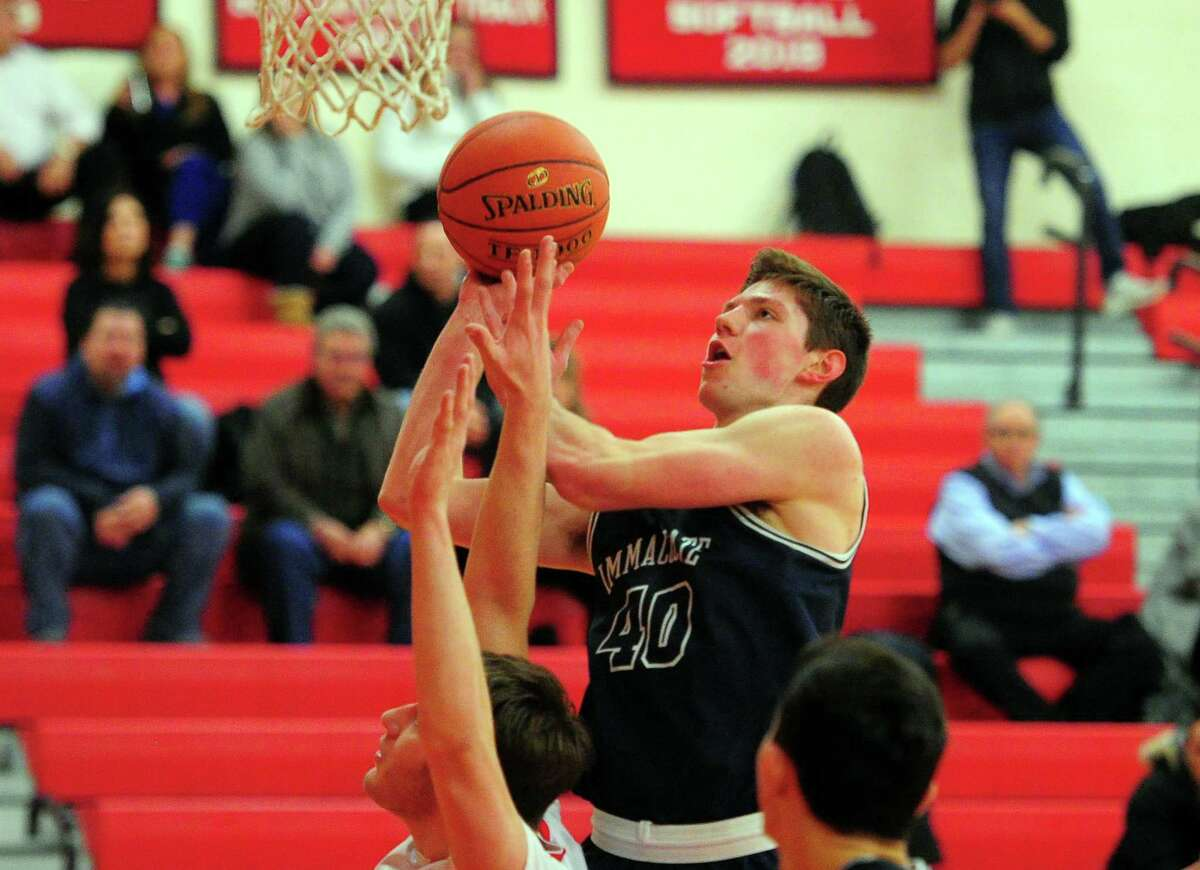 Immaculate's Sean Guiry goes for a layup during Tuesday night's game against Masuk in Monroe. Immaculate won 56-43. For a full report, visit www.newstimes.com.