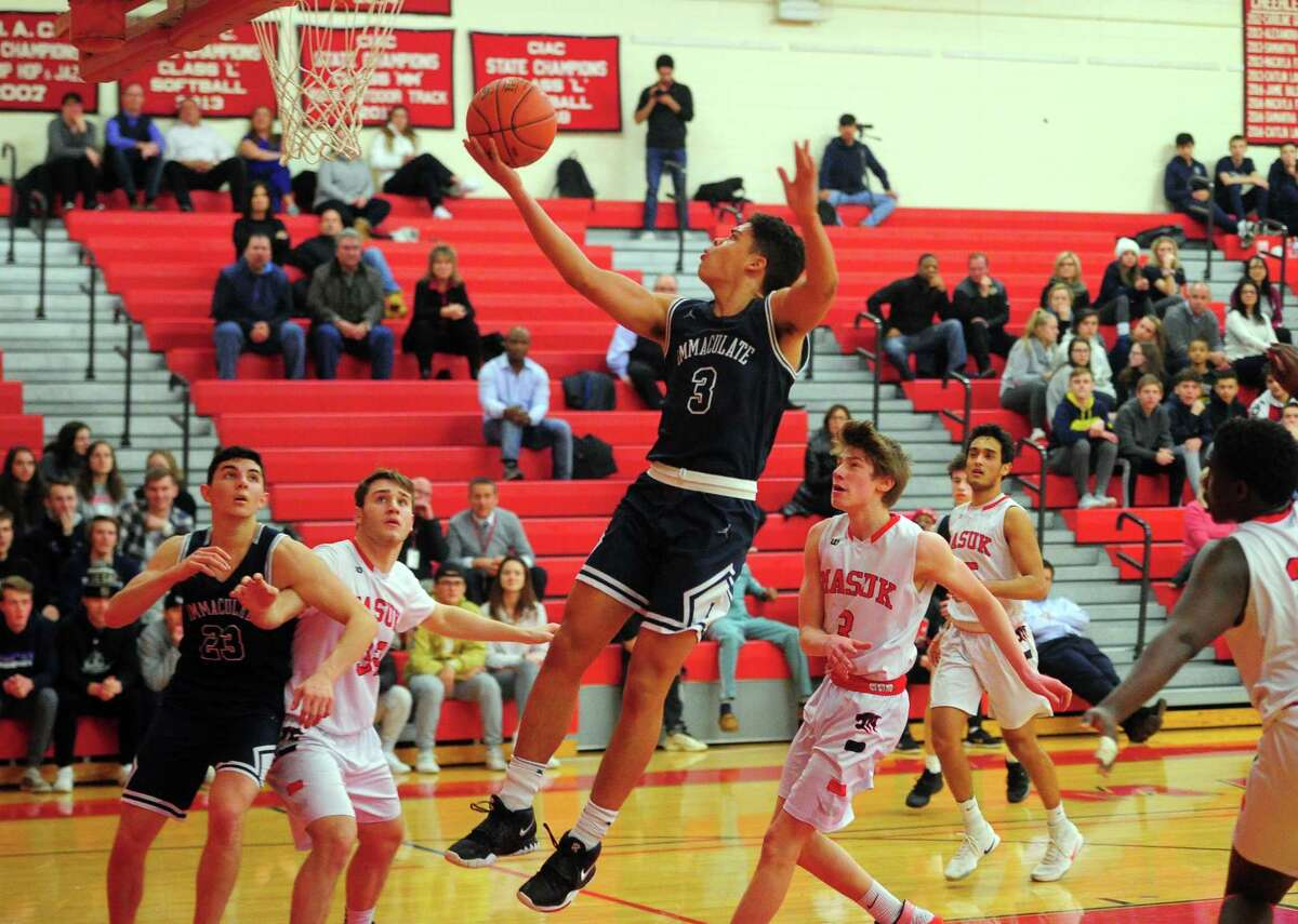 Immaculate's Diego Echavarria (3) goes for a layup during Tuesday night's game against Masuk in Monroe. Immaculate won 56-43. For a full report, visit www.newstimes.com.