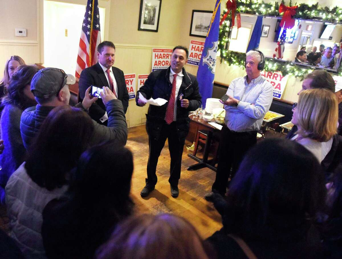 Republican Harry Arora, center, thanks his supporters after it was announced that he won the special election at Caren's Cos Cobber in the Cos Cob section of Greenwich, Conn. Tuesday, Jan. 21, 2020. The businessman Arora beat Democratic nominee Cheryl Moss to take over First Selectman Fred Camillo's former seat as a Representative of the State's 15st District.