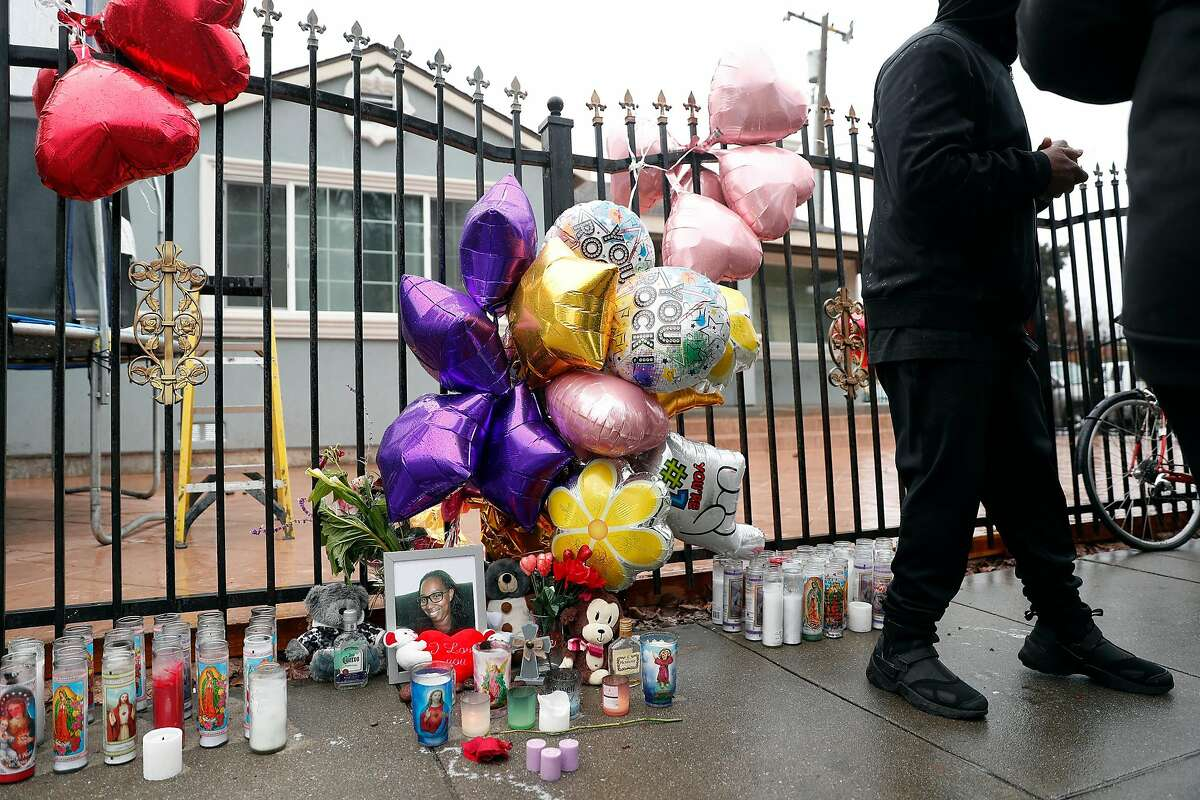 A memorial at the scene of the death by hit and run driver of Miesha Singleton in front of Elmhurst United Middle School in Oakland, Calif., on Tuesday, January 21, 2020.