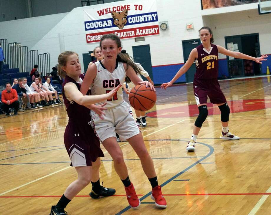 Crossroads sophomore Jessica Cole backs down an opponent during CCA's 42-14 non-conference loss to NMC at home on Tuesday night. (Pioneer photo/Joe Judd)