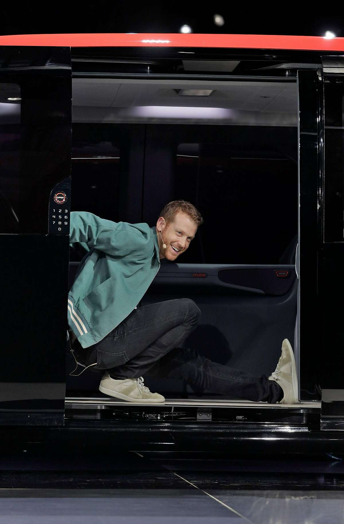 Kyle Vogt shows off the leg room in the new Cruise Origin, which has removed all driver machinery at the unveiling of the Cruise Origin, a fully autonomous passenger vehicle in San Francisco, Calif., on Tuesday, January 21, 2020.