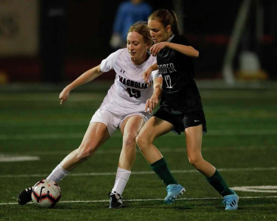 Magnolia's Skylar Replogle (15) controls the ball against John Cooper's Chloe Smith (12) during the first period of a non-district soccer match at The John Cooper School, Tuesday, Jan. 21, 2020, in The Woodlands. Photo: Jason Fochtman, Houston Chronicle / Staff Photographer / Houston Chronicle © 2020