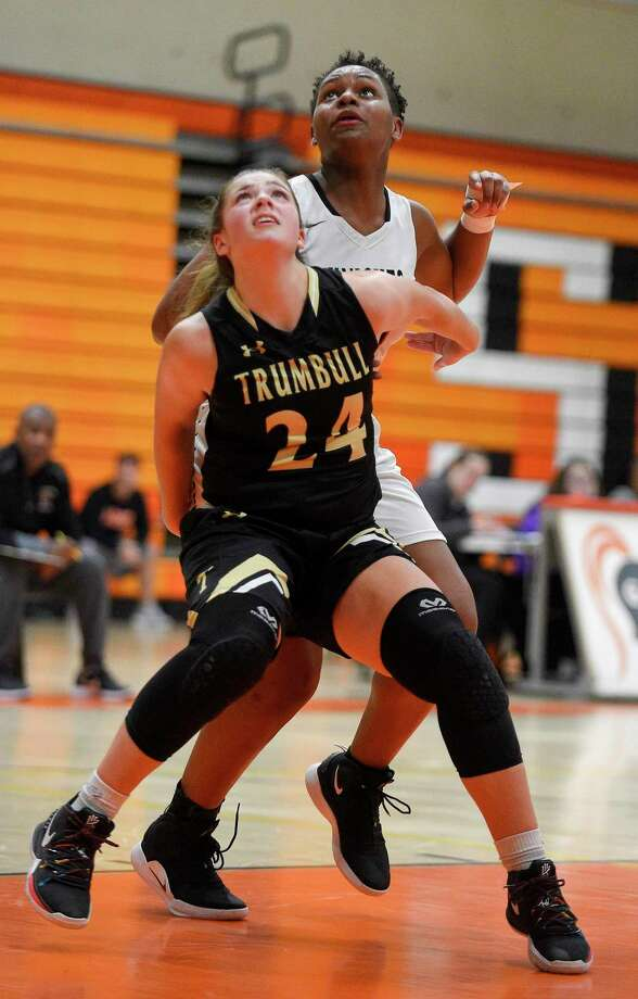 Trumbull's Cassi Barbato (24) battles for position with Stamford Emily Graham (21) in the second half of an FCIAC girls basketball game on Jan. 21, 2020 in Stamford, Connecticut. Trumbull defeated Stamford 46-41. Photo: Matthew Brown / Hearst Connecticut Media / Stamford Advocate