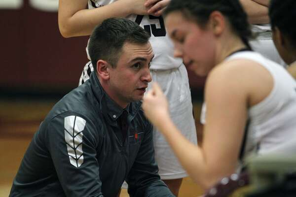 Cass City girls basketball coach Justin Ketterer gives his players instruction on the sidelines during a timeout. The Red Hawks fell to Caro, 48-37, on Tuesday, Jan. 21, 2020.
