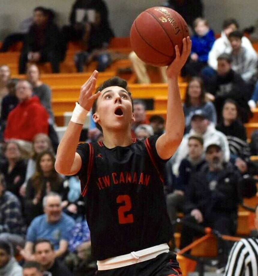 New Canaan's Aaron Fishman (2) goes up for two points during the Rams' boys basketball game against Stamford at Stamford High School on Friday, Jan. 17, 2020. Photo: David Stewart / Hearst Connecticut Media / Connecticut Post