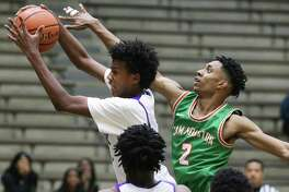 Eagle forward Robert Jackson rips the ball away from Aviar Smith as Sam Houston plays Brackenridge in boys basketball at the Alamo Convocation Center on Jan.21, 2020.