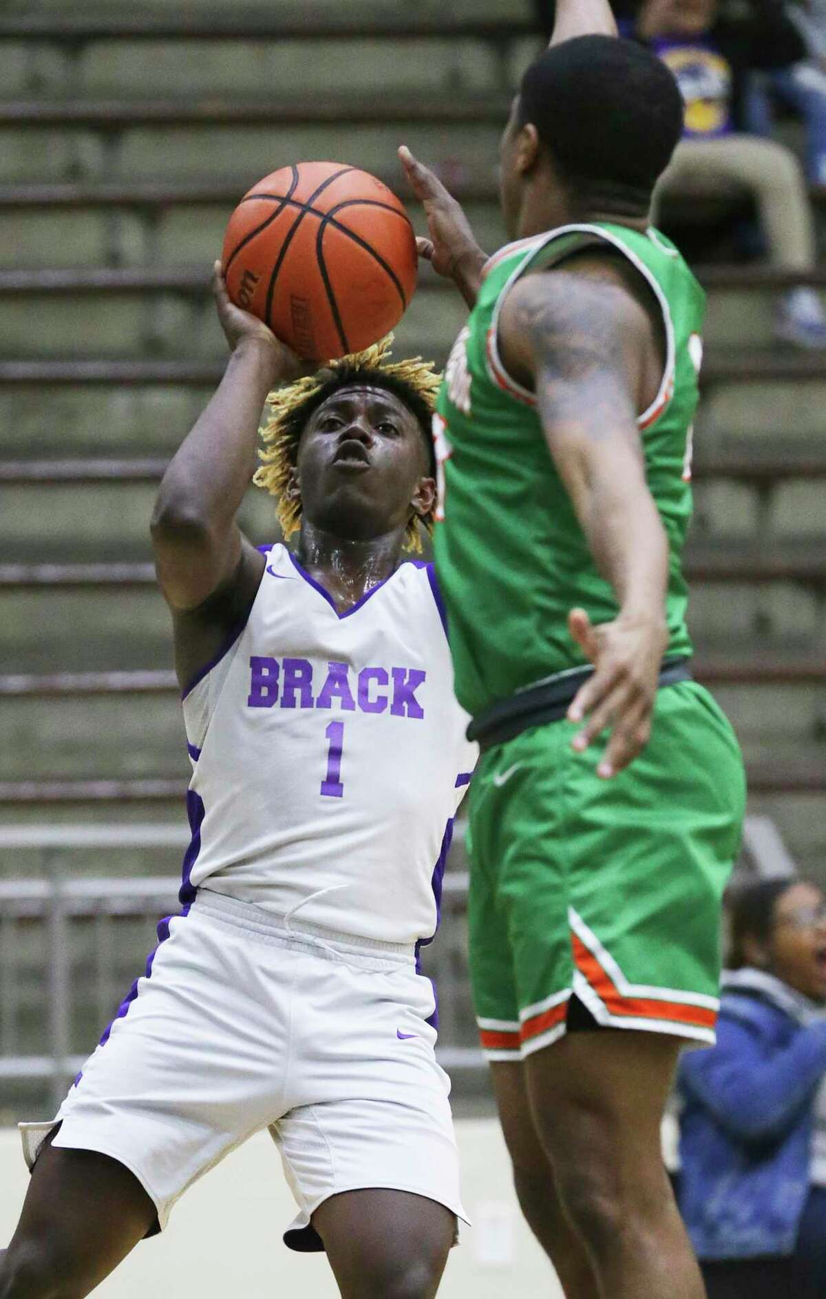 Kalvin Nance eyes the basket from an outside position as Sam Houston plays Brackenridge in boys basketball at the Alamo Convocation Center on Jan.21, 2020.
