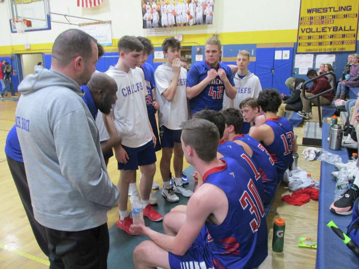 Nonnewaug coach Devonne Parker talks to a bench that got points from eight players in the Chiefs' win over Gilbert at The Gilbert School Tuesday night.