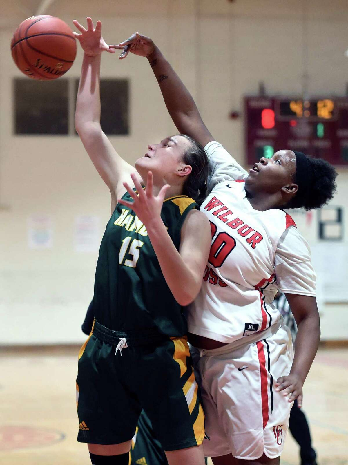 Hamden's Rebecca Oberman-Levine, left, and Wilbur Cross' Kandie Everette fight for a rebound in the first half on Tuesday.