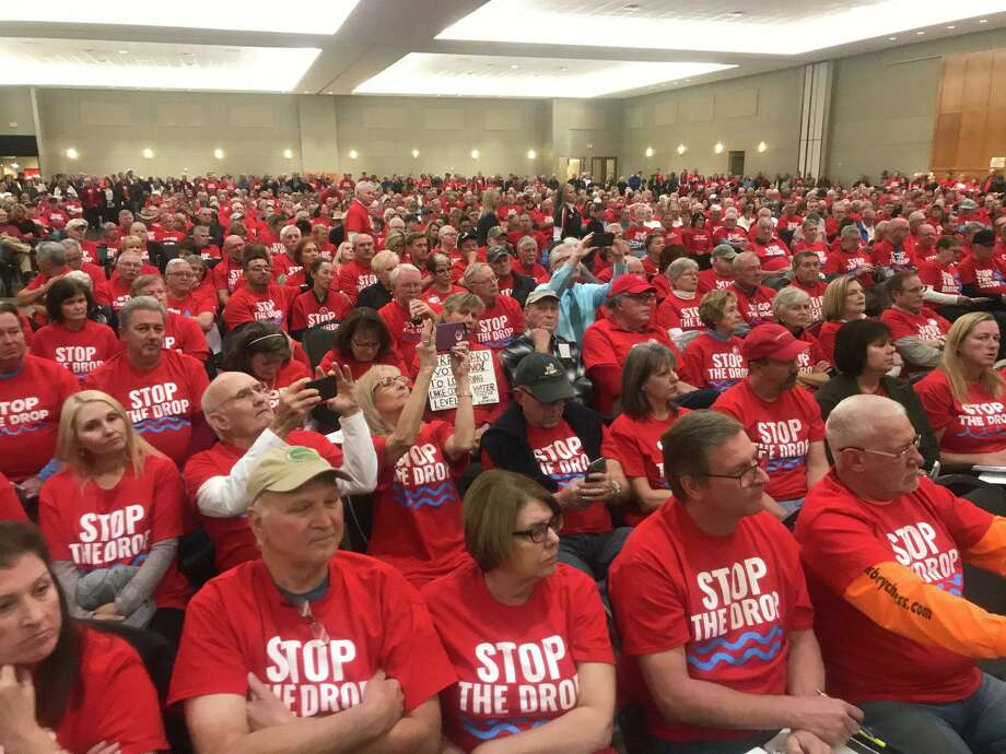 Hundreds of people have packed an SJRA meeting to debate whether it should continue lowering Lake Conroe seasonally, a policy that went in place after Hurricane Harvey. The meeting was relocated to accommodate the expected crowd against it. Photo: Emily Foxhall/Staff Photo