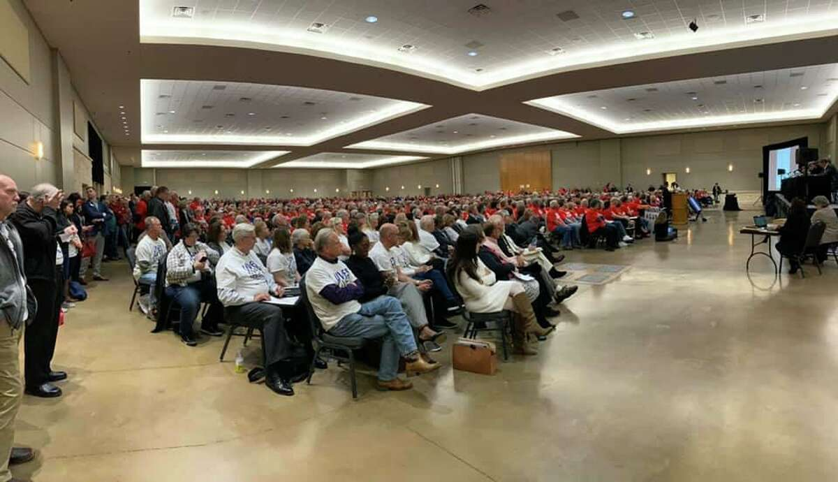 There was a turn out of over 1,000 people at the San Jacinto River Authority Board meeting tonight to discuss the seasonal lowering of Lake Conroe. Some are wearing