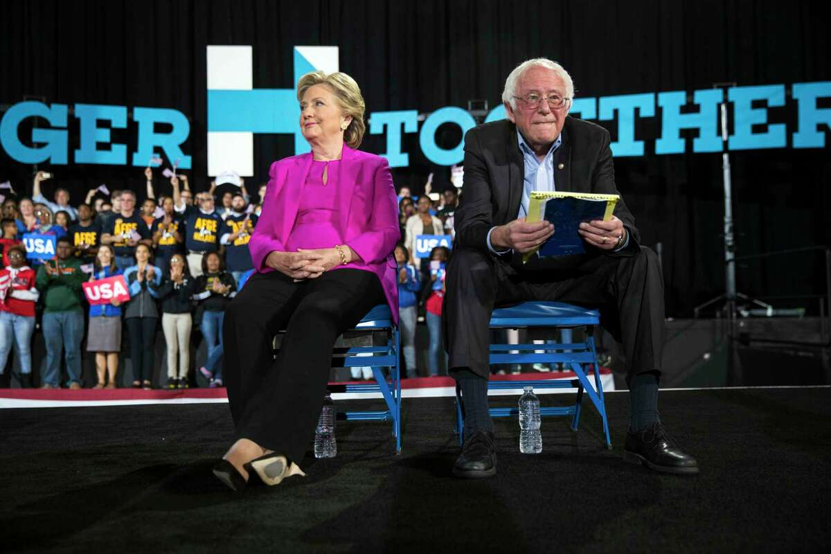 FILE -- Hillary Clinton, then the Democratic presidential nominee, with Sen. Bernie Sanders (I-Vt.), her former rival for the nomination, at a