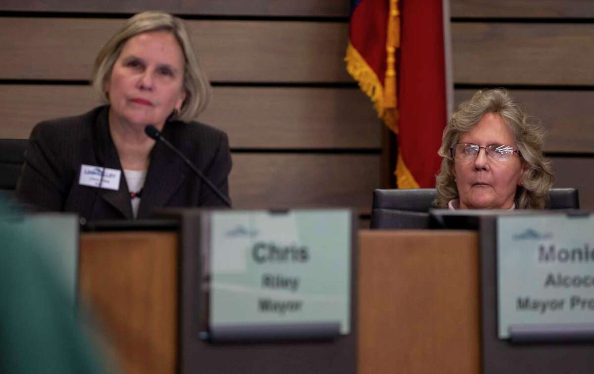 Councilor Monica Alcocer, seated next to Mayor Chris Riley, listens to a speaker during a City Council meeting held in the Leon Valley City Council Chambers in January. Amid deep divisions among the city's elected leaders, Riley is targeted for a possible forfeiture hearing, and Alcocer is the subject of a Nov. 3 recall initiative.