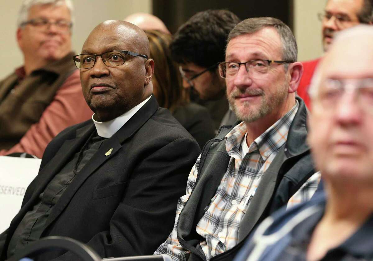 Bishop Grady Morris, Sr. (left) and Harold Arant of VisionQuest Texas (right) appear at the Universal City City Council meeting as they gather to discuss and potentially vote on a zoning request by New Covenant Church, which is looking to lease with VisionQuest to house up to 60 migrant boys at a vacant school building in the San Antonio suburb on Tuesday, Jan. 21, 2020.